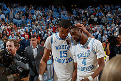 CHAPEL HILL, NC - FEBRUARY 25: Garrison Brooks #15 and Brandon Robinson #4 of the North Carolina Tar Heels embrace after a game against the North Carolina State Wolfpack on February 25, 2020 at the Dean Smith Center in Chapel Hill, North Carolina. North Carolina won 79-85. (Photo by Peyton Williams/UNC/Getty Images) *** Local Caption *** Garrison Brooks;Brandon Robinson