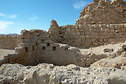 Israel, Masada, remains of buildings, houses and streets Metzada is the site of ancient palaces and fortifications in Israel on top of an isolated rock cliff on the eastern edge of the Judean desert overlooking the Dead Sea. where Jewish zealot insurgents held out for three years against the Romans after the fall of Jerusalem in 70C.E. and then committed mass suicide to avoid capture. Metzada has remained a symbol of Jewish heroism.