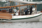 Evenals bij vorige edities van SAIL wordt er een vlootschouw gevaren door het Nederlands Varend Erfgoed dat ook ver buiten onze landsgrenzen bekend is. Deze SAIL zal de vlootschouw van het Varend Erfgoed deels varend en deels liggend worden gehouden. Een representatief deel van het Varend Erfgoed, waarbij elk scheepstype en elke behoudsorganisatie vertegenwoordigd is, zal in front-linie langs het admiraalschip, de Groene Draeck met de Prins van Oranje, varen terwijl een ander deel het admiraalschip aan weerzijden zal flankeren.<br /> <br /> On the photo: The Dutch Royal Familie ( Queen Beatrix, Prince Willem Alexander and Pieter van Vollenhoven) on there boat the Groene Draeck at the SAil 2005, a big sail event.
