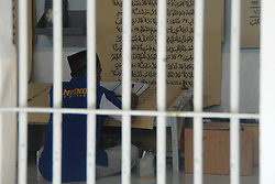 June 19, 2017 - Blitar, East Java, Indonesia - Ahmad Yani, 41 years old, one of the founders of Correctional Institution of class 2 B Blitar, completed the making of Koran which has a length of 120 cm and width of 95 cm which is large, using Samson Kraft paper and black marker. The Qur'an itself was written during the month of Ramadan in its block of rooms. Ahmad Yani confess in this way his closer to the Creator. He admitted that his skills, in writing calligraphy by studying self-taught while serving the punishment, typical child protection in 2013 and by making the Qur'an measuring 110cm long with 80cm wide and has been submitted to the Great Mosque Blitar City. Until now Ahmad Yani has completed 4 juz and is targeted to finished 30 juz in the next 5 months during the remaining time to be the prisoner of Correctional 2 B Blitar. (Credit Image: © Adhitya Hendra/Pacific Press via ZUMA Wire)