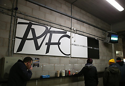 Port Vale fans eat in the concourse before Port Vale's and Coventry City's match at Vale Park