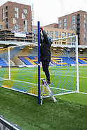 Ground staff putting up the netting during the EFL Sky Bet League 1 match between AFC Wimbledon and Sunderland at Plough Lane, London, United Kingdom on 16 January 2021.