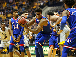 Jan 15, 2018; Morgantown, WV, USA; Kansas Jayhawks center Udoka Azubuike (35) gets a rebound during the second half against the West Virginia Mountaineers at WVU Coliseum. Mandatory Credit: Ben Queen-USA TODAY Sports