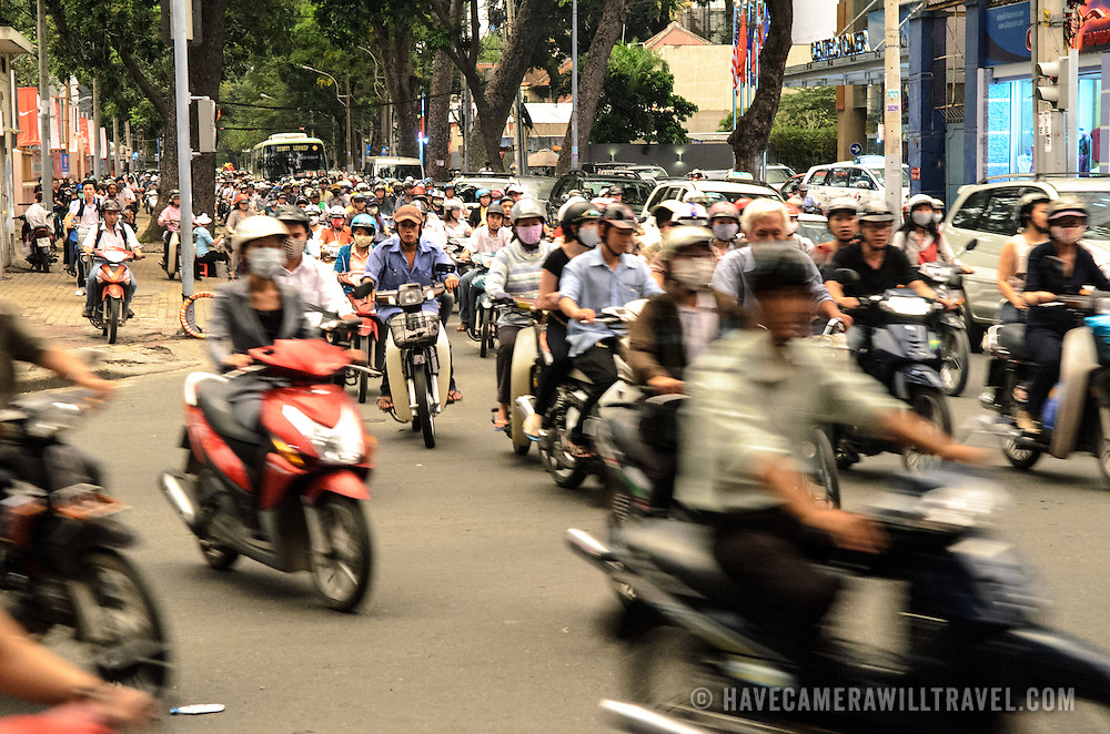 Scooters and bikes in Ho Chi Minh City''s afternoon rush hour.