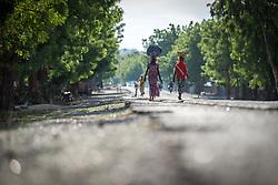 31 May 2019, Mokolo, Cameroon: Women walk along the road to Mokong, in the Mayo-Tsanaga department, far north region, Cameroon.
