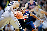SHOT 2/14/13 8:25:12 PM - Arizona's Mark Lyons #2 plays defense on   Colorado's Spencer Dinwiddie #25 during their regular season Pac-12 basketball game at the Coors Event Center on the Colorado campus in Boulder, Co. Colorado won the game 71-58. (Photo by Marc Piscotty / © 2013)