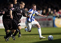 Photo: Olly Greenwood.<br />Colchester United v Brentford. Coca Cola League 1. 01/04/2006. Brentfords Jamie Smith and Colchesters Billy Clarke