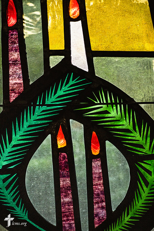 Stained glass depicting Advent with the wreath and candles on Sunday, Aug. 2, 2020, at Elm Grove Lutheran Church, Elm Grove, Wis. LCMS Communications/Erik M. Lunsford