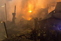 March 23, 2019 - Dhaka, Bangladesh - Firefighters try to control a fire which broke out at a paper warehouse at Lalbagh in Old Dhaka, Bangladesh on March 23, 2019...In recent at least 70 people were killed on February 20, 2019 when a massive fire spread through several apartment buildings in Bangladesh's capital. (Credit Image: © Zakir Hossain Chowdhury/NurPhoto via ZUMA Press)