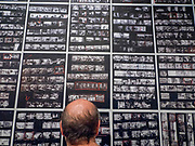"""Portland, Oregon, USA. 26 FEB, 2018. Photographer Robert Frank's contact sheets for The Americans""""  at Blue Sky Gallery in Portland, Oregon, USA. The work was destroyed in a """"Destruction Dance"""" performance defacing the photographs with ink and mutilation with scissors, knives and even ice skates  at the end of it's run. The destruction was Frank's protest regarding today's greed in the global art market."""