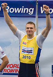Winner Czech republic's Ondrej Synek  celebrates at medal ceremony in finish area after Men's Single Sculls  final A at Rowing World Cup  on May 30, 2010, at Bled's lake in Zaka, Bled, Slovenia. (Photo by Vid Ponikvar / Sportida)