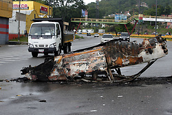 May 3, 2017 - Valencia, Carabobo, Venezuela - A car looks burned and abandoned in the middle of the San Blas sector of Valencia, Carabobo state. Photo: Juan Carlos Hernandez (Credit Image: © Juan Carlos Hernandez via ZUMA Wire)