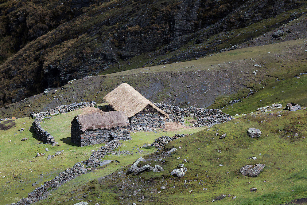 Traditional Peruvian homestead in the Andes. The Interoceanica Sur highway between Cusco and Puerto Maldonado, Peru. A 430 kilometer section of the transcontinental Interoceanic Highway that crosses Peru and Brazil.