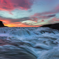 During Iceland's summer, sunset and sunrise merge as one, and the colors of twilight last literally for hours. This is the river, Hvítá, flowing southward towards the waterfall Gullfoss.