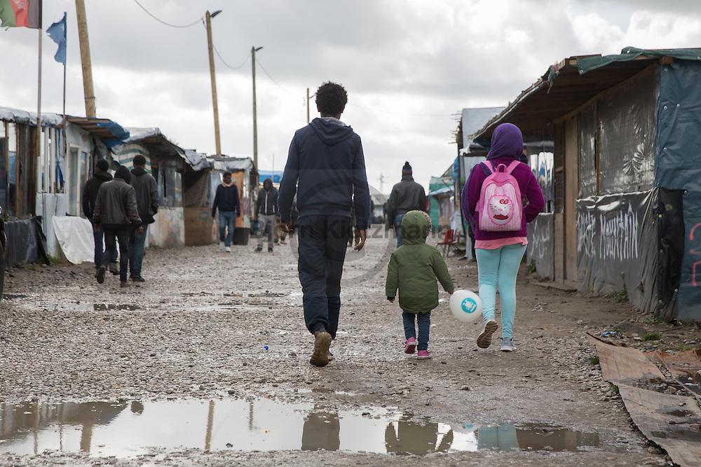 """Calais, Pas-de-Calais, France - 17.10.2016    <br />  <br /> """"Jungle"""" refugee camp on the outskirts of the French city of Calais. Many thousands of migrants and refugees are waiting in some cases for years in the port city in the hope of being able to cross the English Channel to Britain. French authorities announced that they will shortly evict the camp where currently up to up to 10,000 people live.<br /> <br /> """"Jungle"""" Fluechtlingscamp am Rande der franzoesischen Stadt Calais. Viele tausend Migranten und Fluechtlinge harren teilweise seit Jahren in der Hafenstadt aus in der Hoffnung den Aermelkanal nach Großbritannien ueberqueren zu koennen. Die franzoesischen Behoerden kuendigten an, dass sie das Camp, indem derzeit bis zu bis zu 10.000 Menschen leben Kürze raeumen werden. <br /> <br /> Photo: Bjoern Kietzmann"""