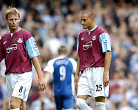 Photo: Olly Greenwood.<br />West Ham United v Reading. The Barclays Premiership. 01/10/2006. West Ham United's Teddy Sheringham and Bobby Zamora look dejected at the end of the game