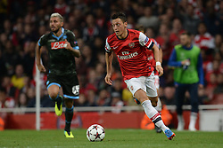 LONDON, ENGLAND - Oct 01:Arsenal's midfielder Mesut Ozil from Germany runs with the ball during the UEFA Champions League match between Arsenal from England and Napoli from Italy played at The Emirates Stadium, on October 01, 2013 in London, England. (Photo by Mitchell Gunn/ESPA)