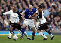 Photo. Aidan Ellis.<br /> Everton v Fulham.<br /> FA Cup 4th Round.<br /> 25/01/2004.<br /> Everton's Thomas Gravesen and Fulham's Louis Boa Morte and Carlos Bocanegra