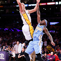 23 November 2014: Los Angeles Lakers guard Jeremy Lin (17) goes for the jump shot over Denver Nuggets guard Ty Lawson (3) during the Los Angeles Lakers season game versus the Denver Nuggets, at the Staples Center, Los Angeles, California, USA.