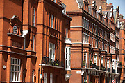 With their grand character of red brick and bay windows, railings and high-celinged rooms, are the grand properties at the junction of Cadogan Gardens and Clabon Mews SW3. On the left is the crest showing Stuart House, set in this parade of fine Victorian houses. Stuart House was constructed in 1880. It is a large red-brick detached house in the 'Queen Anne' style. Cadogan Gardens SW3, is an 1890s development between the King's Road and Sloane Street.