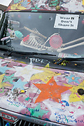As the Coronavirus lockdown continues to ease, a further 155 UK Covid deaths are reported in the last 24 hrs, a total now of 43,730. A skeleton wearing a surgical face mask lies across the windscreen of a van in Herne Hill, on 30th June 2020, in London, England.