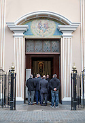 People spilling outside during a funeral at Cathedral of St. Mary the Crowned, Gibraltar, British terroritory in southern Europe