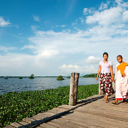 Young nuns crossing U Bein bridge