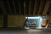 A worker wheels a trolley under the stands of the Tokyo National Stadium in preparation for its demolition to make way for the controversial new 2020 Tokyo Olympic Stadium. Shinjuku, Tokyo, Japan. Friday October 24th 2014