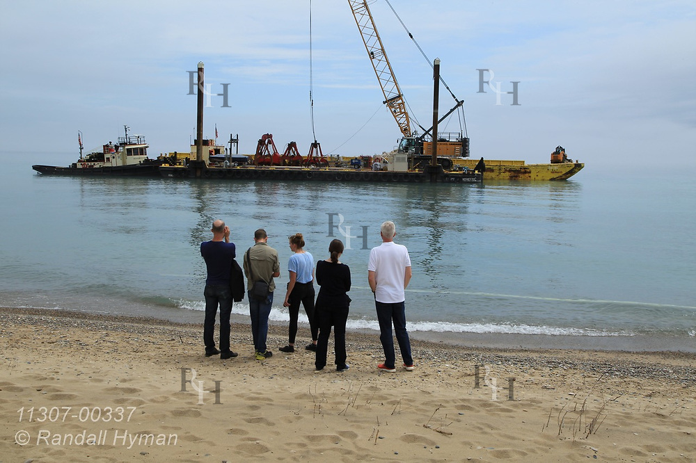 Healthy Ports team watches Army Corps of Engineers use crane and barge to construct underwater rubble ridge designed to disrupt wave energy and reduce shoreline erosion and habitat loss at Illinois Beach State Park; Zion, Illinois.