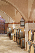 Wine cellar with oak barrels, arched vaulted ceiling. Matusko Winery. Potmje village, Dingac wine region, Peljesac peninsula. Matusko Winery. Dingac village and region. Peljesac peninsula. Dalmatian Coast, Croatia, Europe.