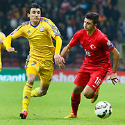 Turkey's Ozan Tufan (R) and Kazakhstan's Ulan Konysbaev (L) during their UEFA Euro 2016 qualification Group A soccer match Turkey betwen Kazakhstan at AliSamiYen Arena in Istanbul November 16, 2014. Photo by Kurtulus YILMAZ/TURKPIX