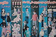 A detail of an Arabic poster for Egyptian childrens' western style clothing outside a shop in Qurna on the West Bank of Luxor, Nile Valley, Egypt.