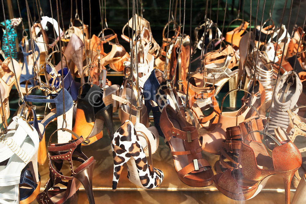 Shop window display of high heeled shoes at Kurt Geiger shoe store.