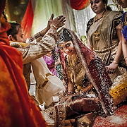 During the Telugu wedding ceremony, the couple sits in a bamboo basket and are not allowed to look at each until the completion of the Kanyādānaṃ (giving away of the bride). They are separated by a curtain placed as a partition between them. Once the curtain is removed, the bride and groom shower one another with Talambralu (rice mixed with saffron and turmeric). This signifies the couple's desire for happiness, enjoyment, and contentment. Initially, they take turns to shower the rice. As it progresses, it gets more entertaining when they begin to compete with each other. <br /> Andhra Pradesh, 2014