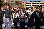 14 JANUARY 2012 - CHANDLER, AZ:    New US citizens take the oath of citizenship during a naturalization ceremony in Chandler, AZ, Jan. 14. More than 140 people from 21 countries were naturalized as United States citizens Saturday in Chandler. This is the third year Chandler has sponsored a naturalization ceremony in connection with the Dr. Martin Luther King holiday.  PHOTO BY JACK KURTZ
