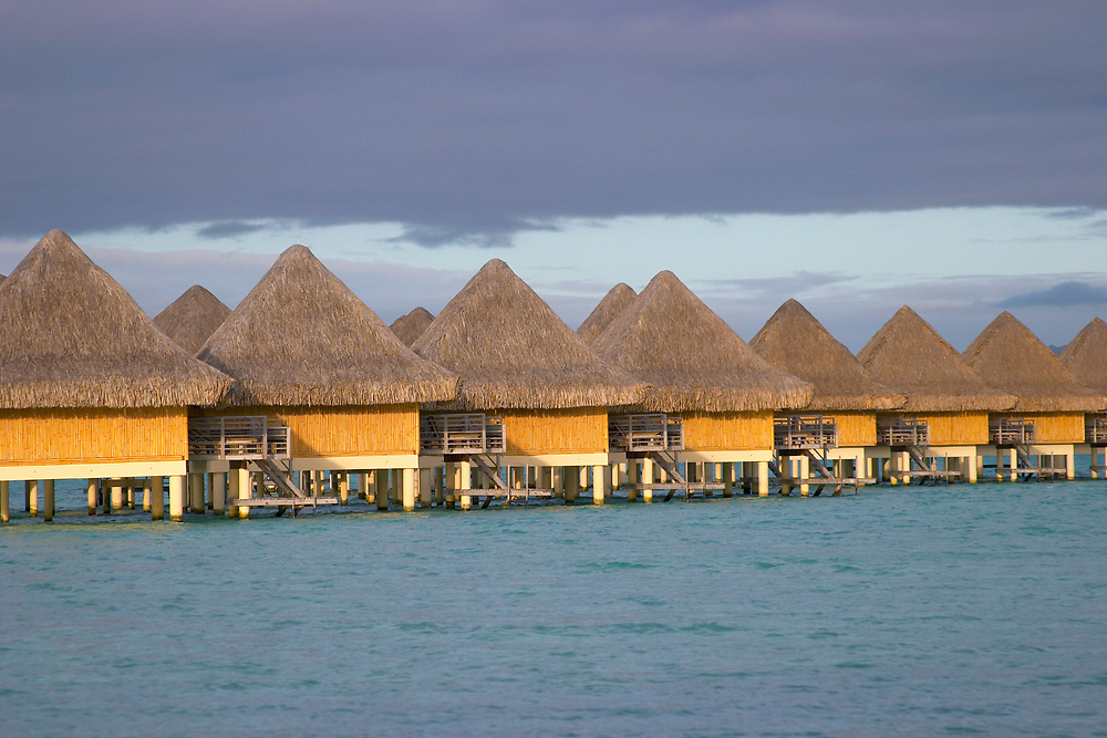 Overwater bungalows in a row, Bora Bora, Society Islands, South Pacific