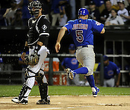 CHICAGO - JUNE 21:  Reed Johnson #5 scores the tying run after Aramis Ramirez #16 of the Chicago Cubs hit a sacrifice fly in the sixth inning against the Chicago White Sox on June 21, 2011 at U.S. Cellular Field in Chicago, Illinois.  The White Sox defeated the Cubs 3-2.  (Photo by Ron Vesely)  Subject:  Aramis Ramirez;Reed Johnson