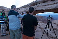 Photographers gather for dawn at Mesa Arch, Utah. Picture by Andrew Tobin.