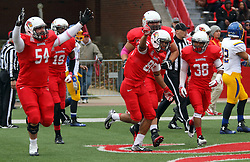 04 October 2014: Redbirds including Mark Spelman, Cameron Meredith, Rocco Ammons and Jamal Towns help Lechein Neblett celebrate a reception for TD during an NCAA FCS Missouri Valley Football Conference game between the South Dakota State Jackrabbits and the Illinois State University Redbirds at Hancock Stadium in Normal Illinois