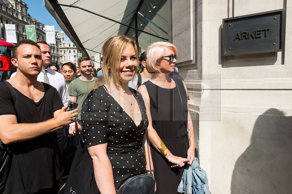 © Licensed to London News Pictures. 25/08/2017. London, UK. Customers queue outside for the opening of H&M group's first ARKET flagship store in Regent Street. ARKET has called itself a modern day market seeing not only clothes, but homeware as well as a small cafe spacePhoto credit: Ray Tang/LNP