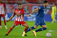 PIRAEUS, GREECE - DECEMBER 09: Marko Grujić of FC Porto and Youssef El-Arabi of Olympiacos FC during the UEFA Champions League Group C stage match between Olympiacos FC and FC Porto at Karaiskakis Stadium on December 9, 2020 in Piraeus, Greece. (Photo by MB Media)