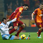 Galatasaray's Selcuk Inan (C) during their Turkish superleague soccer derby match Galatasaray between Trabzonspor at the AliSamiYen spor kompleksi TT Arena in Istanbul Turkey on Sunday, 22 December 2013. Photo by TURKPIX