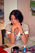 Woman age 19 at her desk deep in thought.  Torun Poland