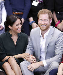 """File photo dated 03/10/18 of the Duke and Duchess of Sussex, who are """"very pleased"""" that Meghan is expecting a baby in the spring of 2019, Kensington Palace said."""