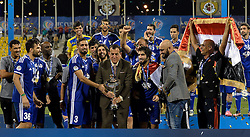Iraq's Air Force Club coach Basim Qasim Hamdan al-Suwaid (C) raises the trophy as he celebrates on the podium with his team after beating India's Bengaluru FC to win the AFC Asian Cup football final at the Suheim bin Hamad Stadium in Doha,Qatar on November 5, 2016.Air Force Club won 1-0 and claimed the title of the event. (Credit Image: © Nikku/Xinhua via ZUMA Wire)