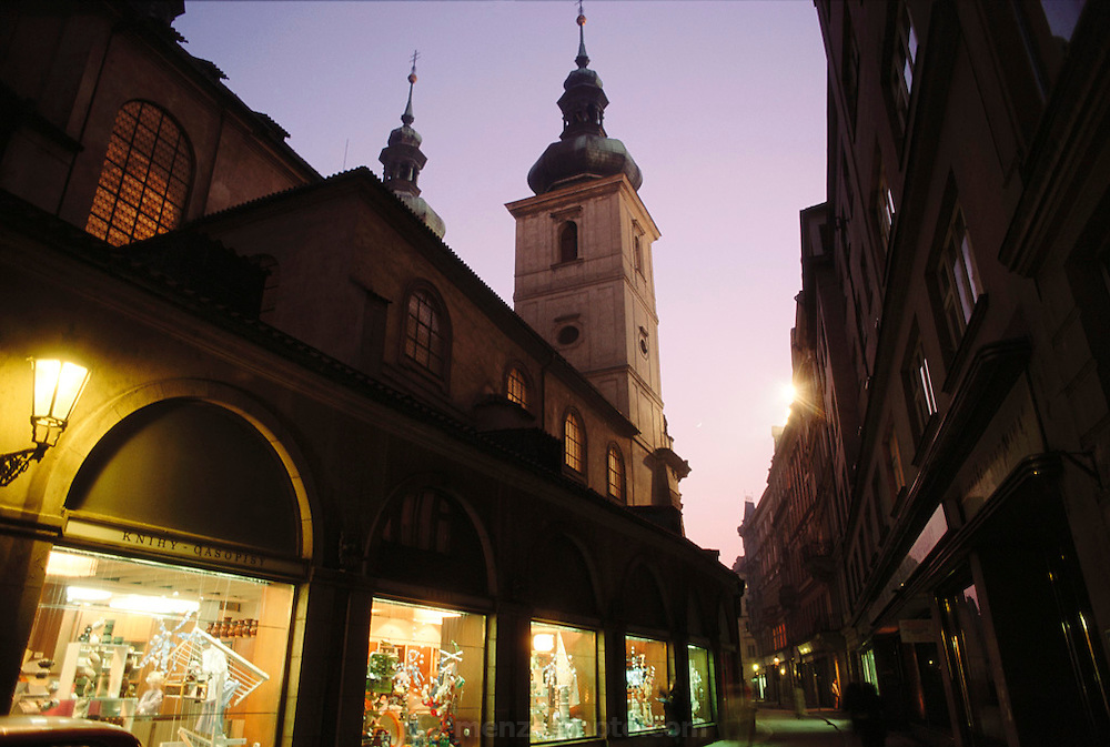 Prague, Czech Republic. Old town street at dusk with lighted shop windows.