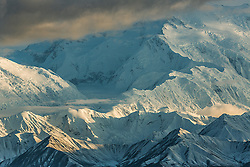 """Sunset on Denali -""""the High One"""" or """"Great One"""" in the Koyukon Athabaskan language. This image shows Pioneer Ridge from the road near Wonder Lake. Denali is the tallest land-based mountain on Earth—with a vertical rise of about 18,000 feet, as well as the highest peak in North America—with a summit of 20,310 feet.  Like most big peaks in the world """"The Great One"""" is bigger than life, a kind of transcendent thing, beyond time. I consider Denali to be one of our great American Cathedrals.<br /> <br /> BIO: Aaron Huey is a National Geographic photographer and Explorer, a Stanford d.School Fellow, and Founder + Chief Creative of Amplifier.org. <br /> <br /> As a photographer Huey has created over 30 stories for the National Geographic magazines including several cover stories.   As a Stanford Knight Fellow and then as one of the first d.School Media Experiments Fellows, Huey focused on using the human centered design process in both the analog and digital world to evolve his storytelling.  That resulted in many projects beyond traditional photography, including the evolution of his art and advocacy non-profit Amplifier, where he created the global art phenomenon called """"We The People"""" with a small team now based in South Seattle. <br /> <br /> Huey's Bear Ears Virtual Museum VR experience, won the Webby for best VR Interactive Design in 2019 and parts of that project will become Pre-Colonial History and Cultural Heritage lessons in AR and VR for K-12 classrooms across the US in 2021. <br /> <br /> Huey is currently working on a set of new AR experiments, and the revival of the Wide Awakes Movement.  But, perhaps most importantly, Huey was named the 3rd coolest Dad in America by Fatherly.com after Lebron James and Kelly Slater. <br /> <br /> WEBSITE: helloprototype.com<br /> INSTAGRAM: @argonautphoto"""