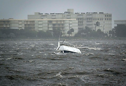 September 10, 2017 - Lake Worth, Florida, U.S. - A boat is partially submerged in choppy waters in the Intracoastal Waterway near Bryant Park during Hurricane Irma. (Credit Image: © Bruce R. Bennett/The Palm Beach Post via ZUMA Wire)
