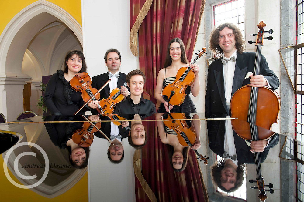 26/02/2013 Repro free. The Galway Music Residency will kick off its first ever festival, tomorrow February 27th in NUIG with three full days of lunchtime events, workshops and evening concerts. The Festival which has been organised in partnership with Music For Galway is the final celebration in a year- long programme of anniversary activities marking ten years of making and sharing music in Galway City, County and beyond...Over the next three days, The Galway Ensemble in Residence, ConTempo String Quartet (( from left)Ingrid Nicola Bogdan Sofei,  Adrian Mantu and Andreea Banciu) who will be joined by Irish Pianist Isabelle O' Connell, ( seated ) and the RTE Vanbrugh Quartet, Argentinian Guitarist Ariel Hernandez & Irish Accordionist Dermot Dunne for a series of evening concerts featuring favourites of audiences from concerts played over the last decade. The musical programme will cater to all tastes ranging from contemporary Irish through to favourite classics and even some Latin American and popular music! Picture:Andrew Andrew Downes..A series of free lunchtime events will include a solo performance by Galwegian Cellist and vocalist Naomi Berrill, a reading from local poet Kevin O' Shea and an open discussion about ?the Making of Music? between Composer in Residence Karen Power and celebrated composer and founder of The Galway Music Residency Jane O' Leary. The festival will also feature a number of workshops for primary and secondary students with Dermot Dunne and Karen Power and a Piano Masterclass with Isabelle O' Connell. All are welcome to come along to these events for free but booking is advisable.