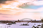 Military aircraft demonstrations over the Harbour Bridge for the International Fleet Review, Sydney, Australia. 5th Oct 2013